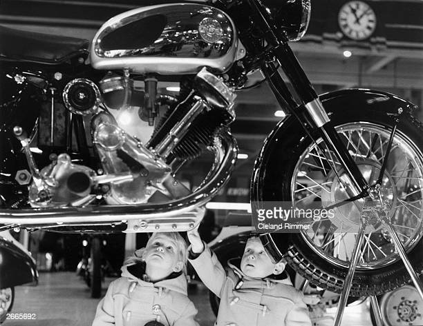 Three year old Malcolm Brown and his sister, four year old Vanessa admiring a Panther motorcycle at a motor cycle show.