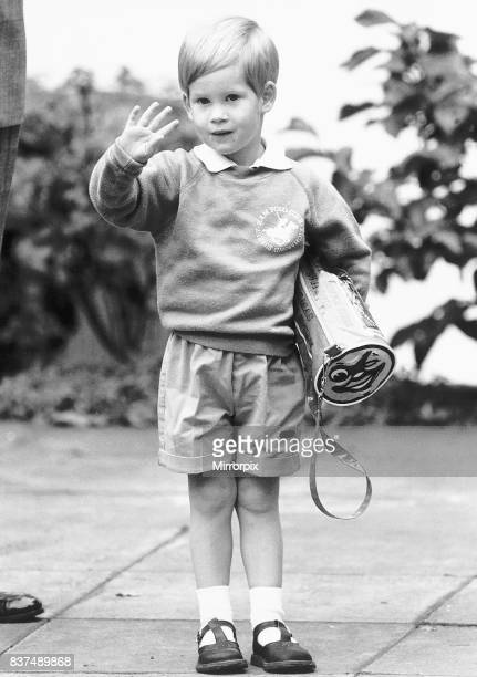 Three year old Prince Harry waves to the waiting croud on his first day at the nursery school Chepstow Villas in Kensington.