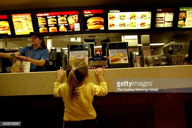 Three year old Tegan Bush from Ryde waiting for her Happy Meal at McDonald's in Sylvania 8 June 2006 SMH Picture by LISA WILTSE