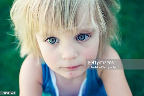Three year old with big blue-green eyes