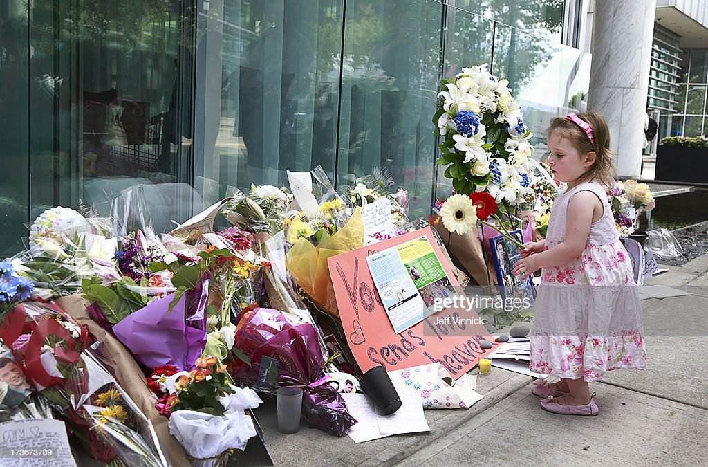 Three year-old Rebecca Brown walks past a memorial to deceased actor Cory Monteith outside the Fairmont Pacific Rim Hotel on July 16, 2013 in Vancouver, British Columbia, Canada. The B.C. Coroners Service released results of Monteith's autopsy today and found the 31-year-old's cause of death was 'a mixed drug toxicity, involving heroin and alcohol.'