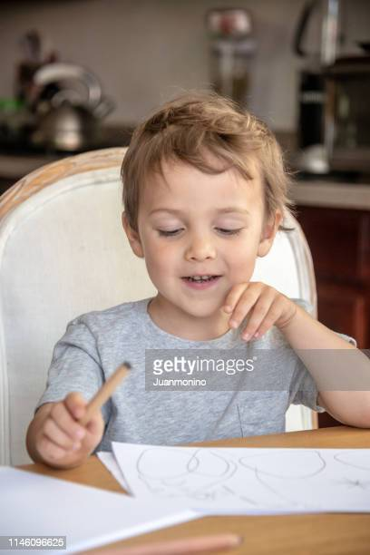 three years old child boy doing his homework - 2 3 years stock pictures, royalty-free photos & images