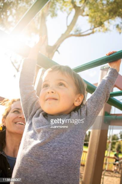 three years old child playing at the playground - 2 3 years stock pictures, royalty-free photos & images