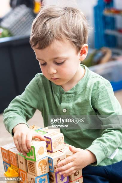 three years old child playing with his alphabet blocks - 2 3 years stock pictures, royalty-free photos & images