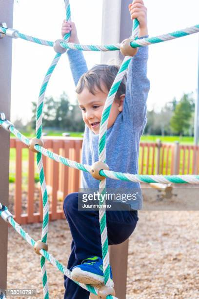 three years old child toddler playing at a park playground - 2 3 years stock pictures, royalty-free photos & images