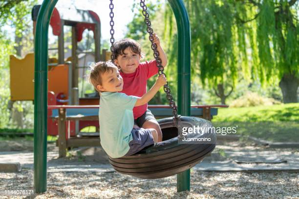 three years old children playing in the park playground - 2 3 years stock pictures, royalty-free photos & images