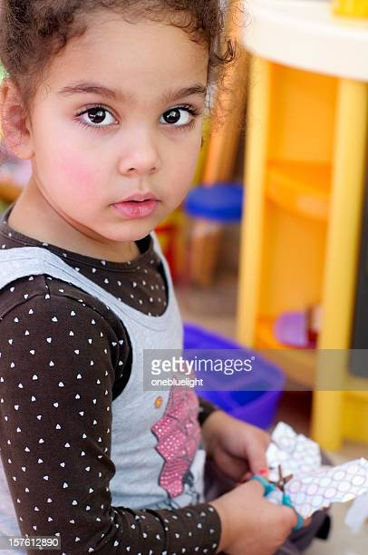 three years old girl cutting paper using scissors - 2 3 years stock pictures, royalty-free photos & images