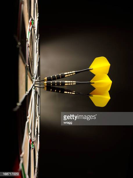 Three Yellow Darts in a Dartboard