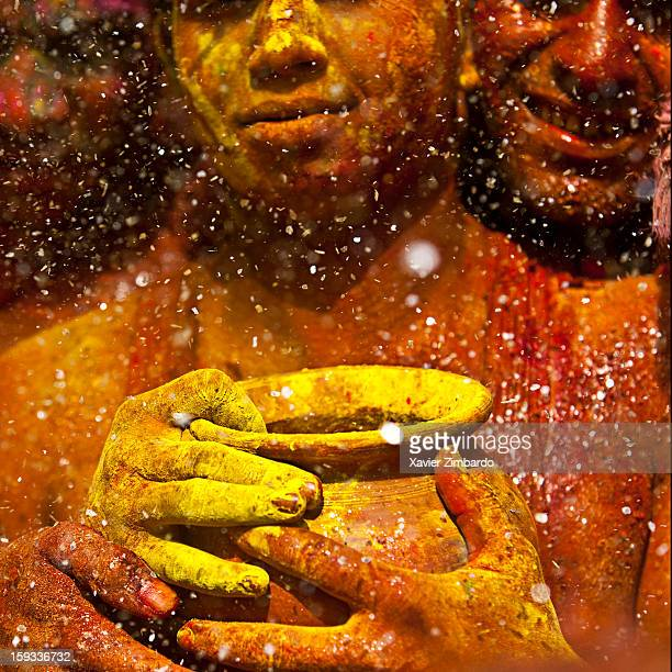 Three yound men with a pot of Gulal the holy powder used during Holi in the Daujee ka Mandir temple on March 15 at Baldev India
