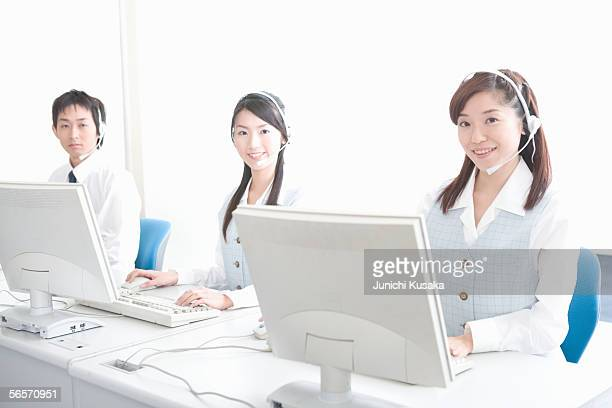 Three young adults wearing headsets