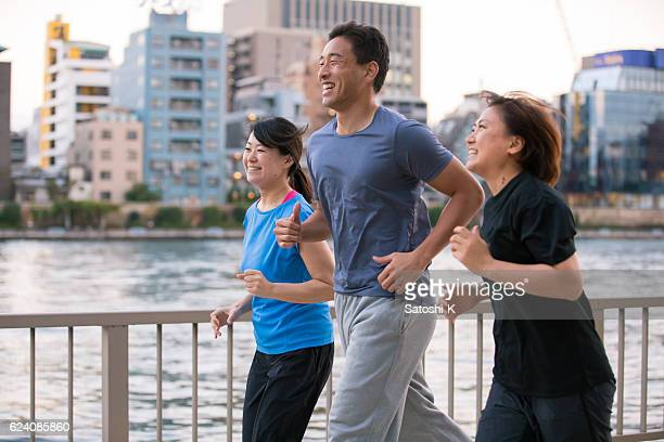 Three young athlete running nearbby river