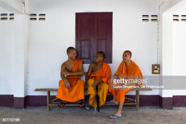 Three young buddhist novices in Luang Prabang, Laos
