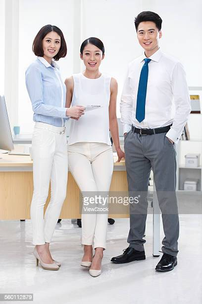 Three young business people in office