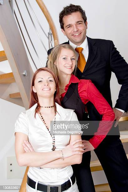three young businesspeople - plus key stock photos and pictures