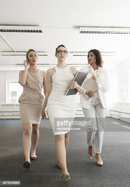Three young businesswomen meeting in new office