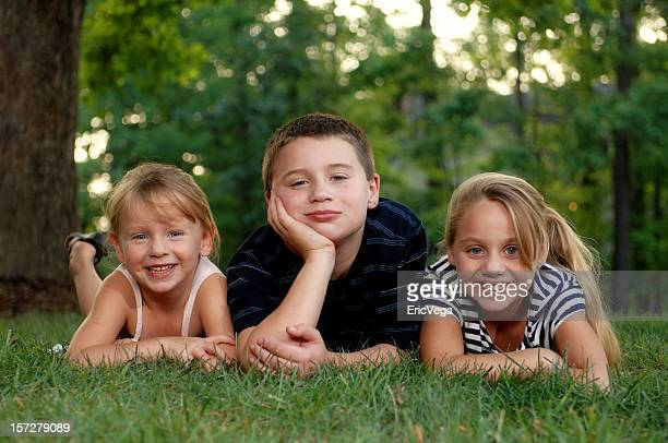 Three Young Children In the Lawn