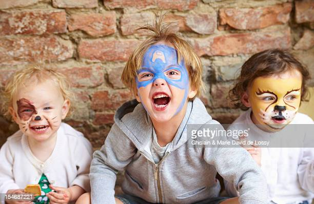 three young children with party make up roaring - kids makeup stock pictures, royalty-free photos & images