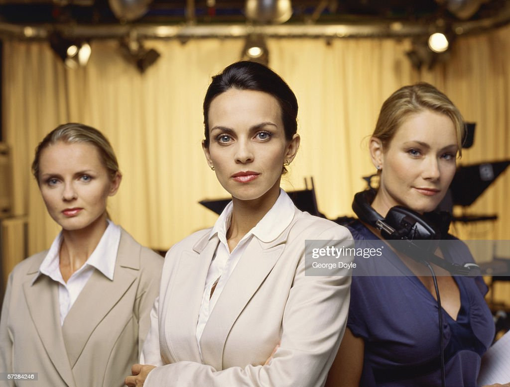 Three Young Female Tv Presenters Standing In A Studio Stock Photo