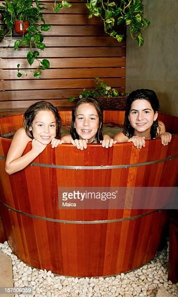 Three young girls i a furo bathtub