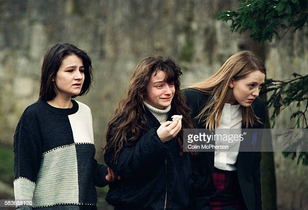 Three young girls one crying outside Dunblane primary school Scotland shortly after the shooting incident on the premises The Dunblane school...