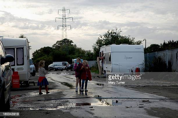 Three young girls walk together on the road leading up to the Dale Farm site on October 18 2013 in Crays Hill England Two years on from the mass...