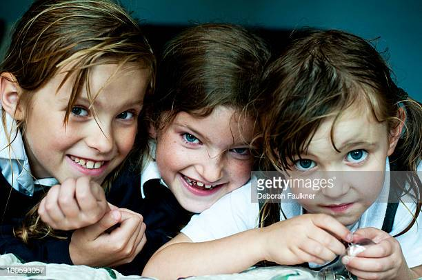 Three young girls with damp hair