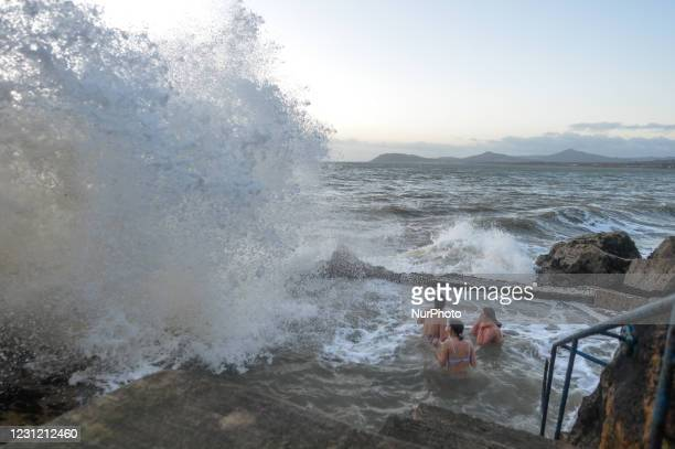 Three young ladies take a dip in the sea at Vico's Bathing Site, Hawk Cliff in Dalkey, during Level 5 COVID-19 lockdown. On Tuesday, February 16 in...
