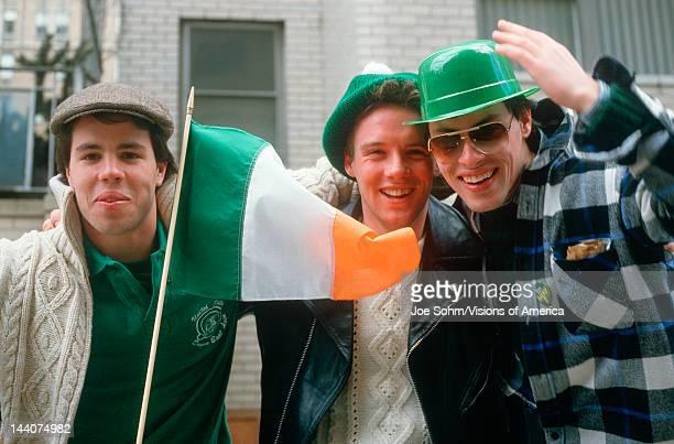 Three young men enjoying the 1987 St Patrick's Day Parade NY City