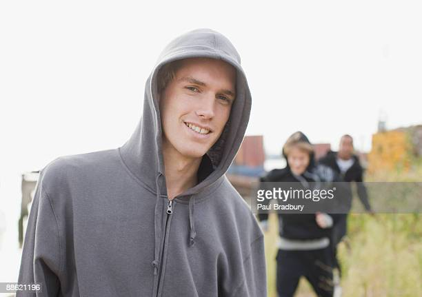three young men walking through urban field - hooligan stock pictures, royalty-free photos & images
