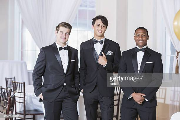 Three young men wearing tuxedos