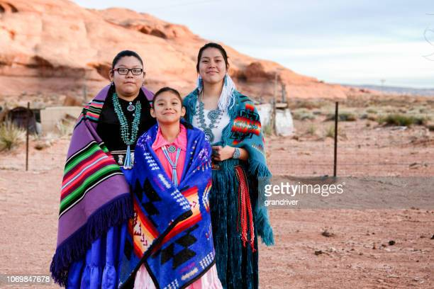 three young navajo sisters in monument valley arizona - indigenous culture stock pictures, royalty-free photos & images