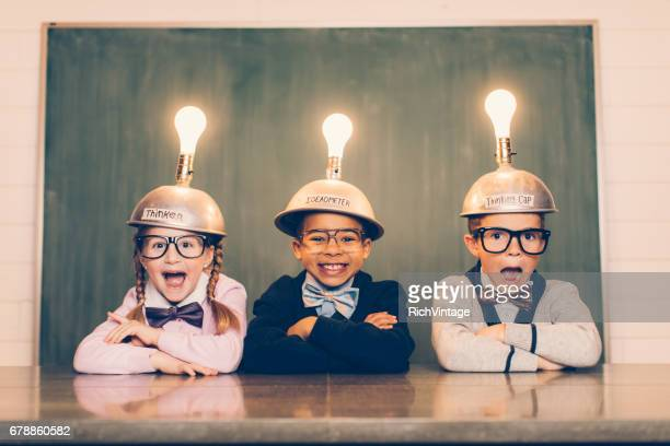 three young nerds with thinking caps - light bulb stock pictures, royalty-free photos & images