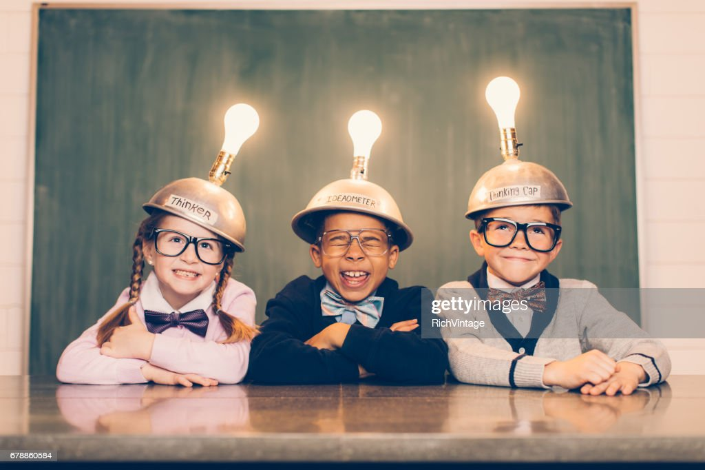 Three Young Nerds with Thinking Caps : Stock Photo