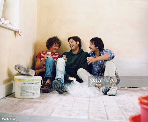 Three Young People Having a Break from Renovating a Room