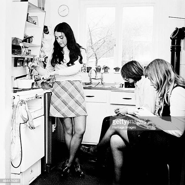 Three young people in the kitchen of a London flat c1960s