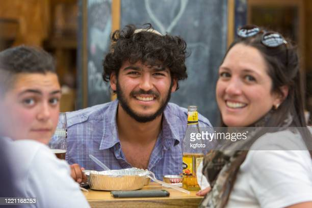 three young people looking at the camera, laughing with open mouth at famous market of jerusalem old city, israel - israeli ethnicity stock pictures, royalty-free photos & images