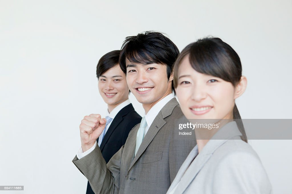 three young people making a pose ストックフォト getty images