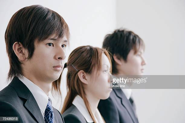 Three young people waiting for job interview