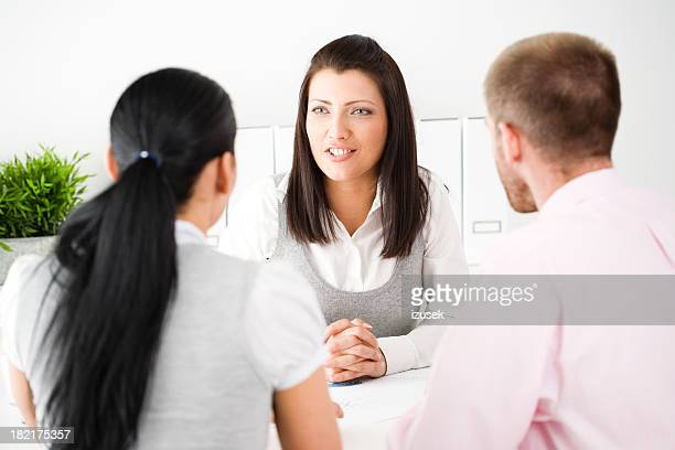 three young professionals in a business meeting - izusek stock photos and pictures