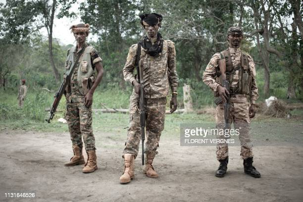 Three young UPC militiamen protect their base in Bokolobo, near Bambari on March 16, 2019. - Based in Bokolobo, the armed group UPC , claiming to...