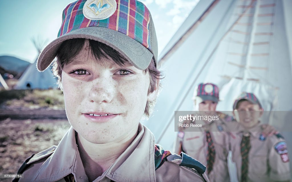 Three young, Weblo Boy Scout friends standing near a teepee at their camp in Colorado. : Stock Photo