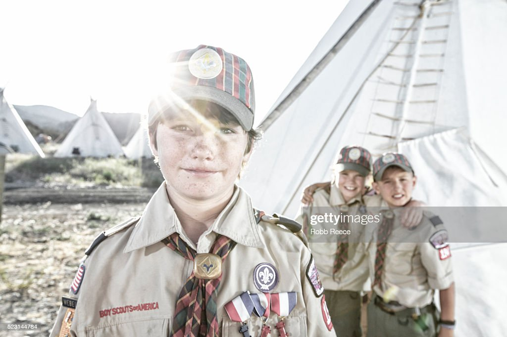 Three young, Weblo Boy Scouts standing near a teepee at a camp in Colorado. : Stock Photo