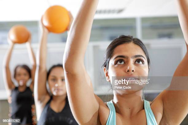 Three young woman in exercise glass