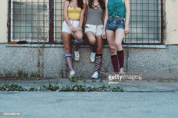 Three young woman talking on the street