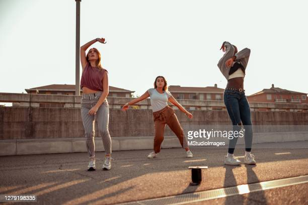 three young women dancing on the street - hipster culture stock pictures, royalty-free photos & images