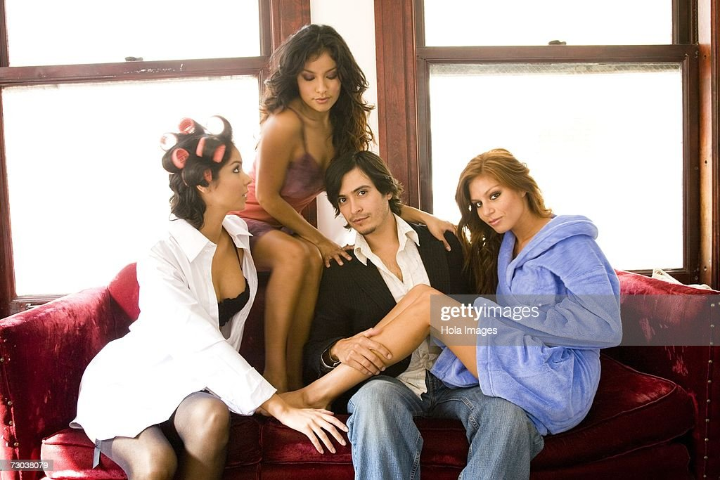 Three young women flirting with handsome man : Stock Photo