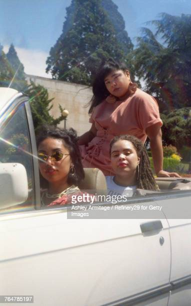 Three Young Women Hanging Out In Car