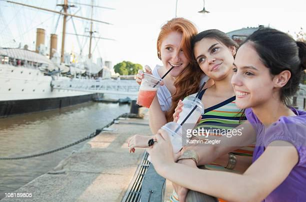 three young women having smooties