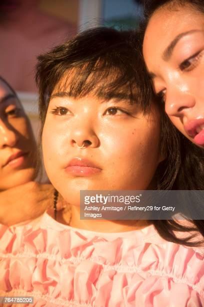 Three Young Women In Bedroom