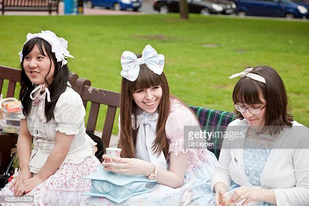 """three young """"sweet lolitas"""" having a picnic in glasgow - lolitas stock pictures, royalty-free photos & images"""